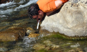 Drinking from a river with the Seychelle Advanced Pure Water Straw