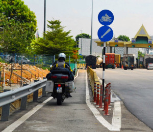 Free motorcycle toll lanes in Malaysia.