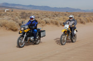 A BMW R1200GS rides next to a Suzuki DR350