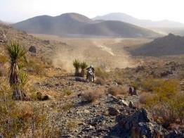 KTM 640 Adventure attempting steep rocky hillclimb