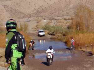 Riders and cars take turns crossing the mojave river