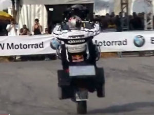 Chris Pfeiffer makes his fully accessorized BMW R1200GS Wheelie.
