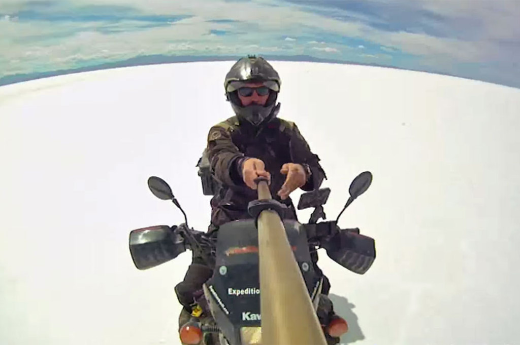 Alex Chacon rides the world's largest salt flat Salar de Uyuni.