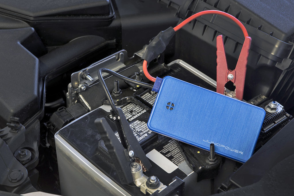small external battery charger will jump start a motorcycle - adv