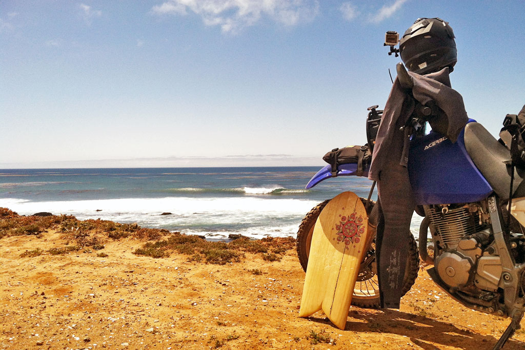 Carrying a surfboard on your motorcycle.
