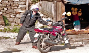 Simon Gandolfi riding a TVS 125 up to a Himalayan Pass