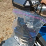 You can pre-soak your vest and carry it in a ziploc bag, then put it on wet and ready when the temperature climbs.