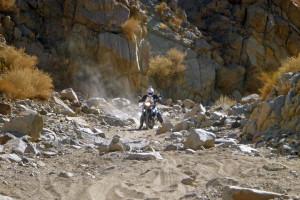 sandy wash jagged rocks.