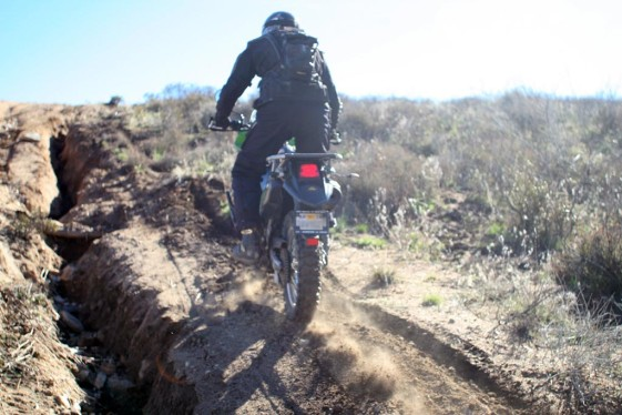 KLR on rutted out hill climb