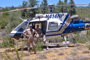 helicopter pilots saving riders in survival situation