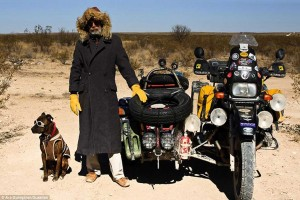riding a motorcycle with a sidecar and dog
