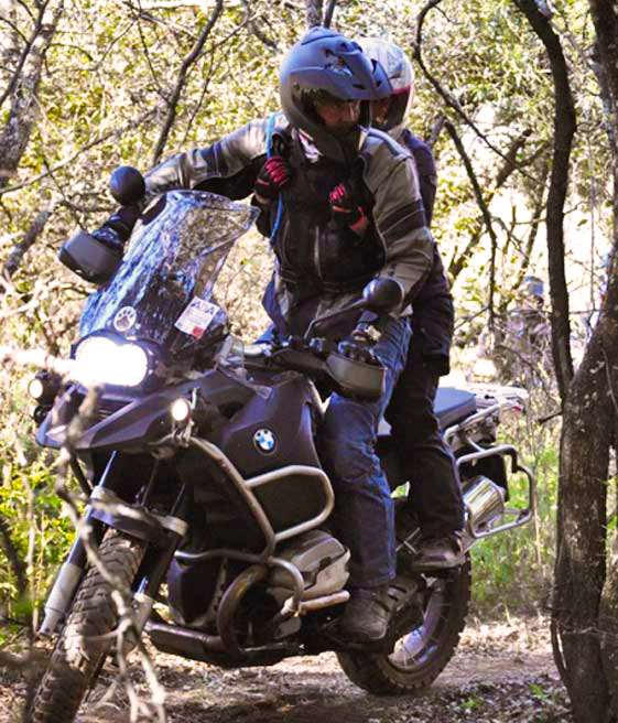 Riding pillion stand-up riding off-road
