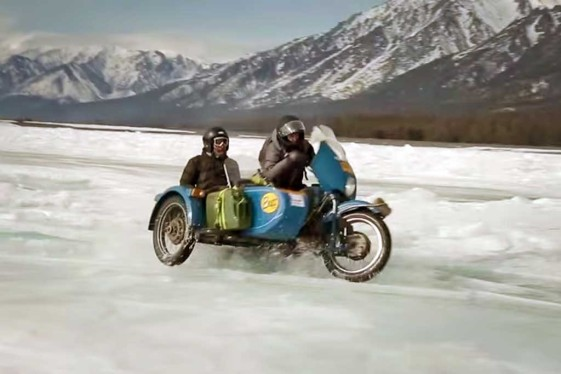Ural sidecar riding across siberia's lake baikal