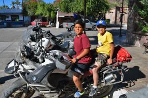 kids in san ignacio sitting on bike