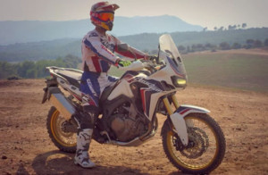 Marc Marquez sitting on new africa twin
