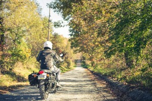 Triumph Scrambler riding down a lonely road