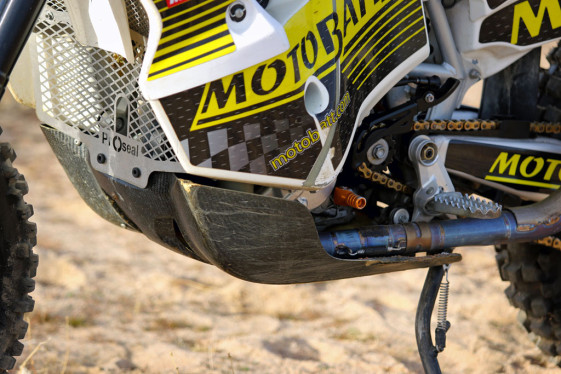 The KTM 450 Rally wide skid plate protects exhaust manifold.