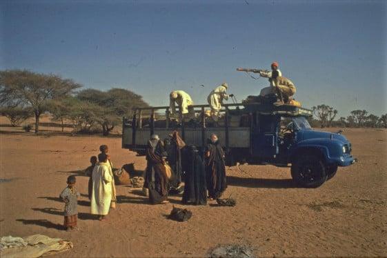 Ted Simon traveling through a war zone.