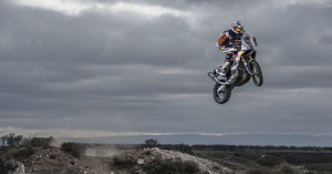 Dakar Rally Racer Toby Price jumping a big bike.