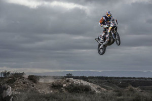 Dakar Rally Racer Toby Price jumping a big bike.