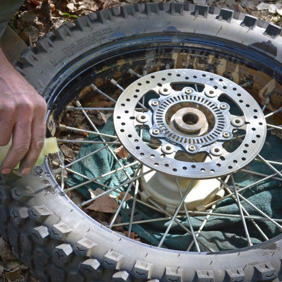 motorcycle puncture repair lubing the bead
