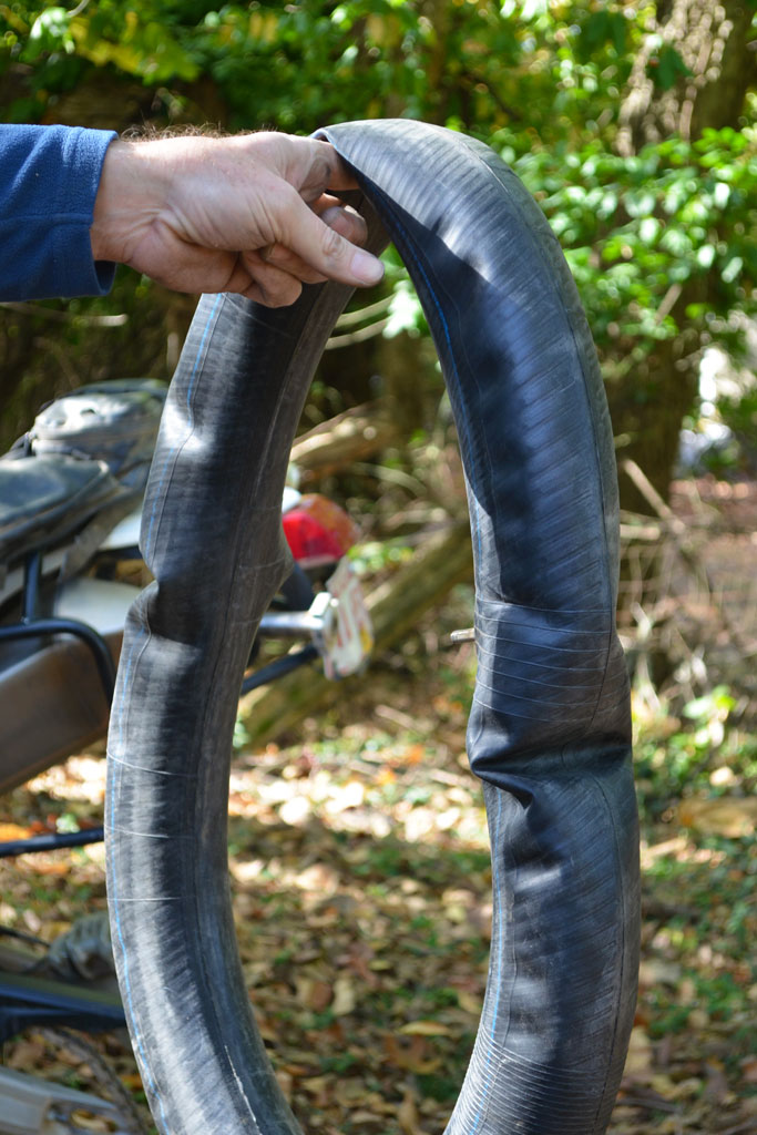 motorcycle puncture repair tips: partially inflate the tube