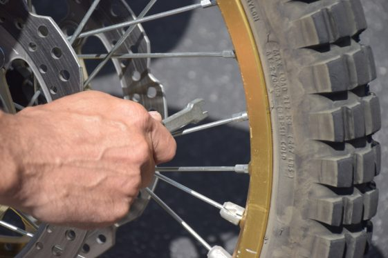 Truing wire-spoke wheel