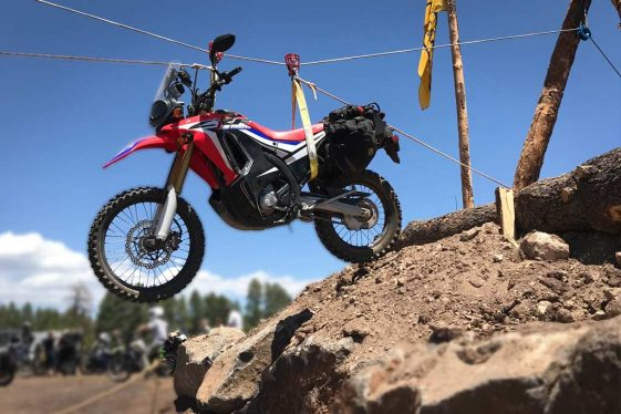 Honda CRF250L Rally being hoisted at Overland Expo West 2018