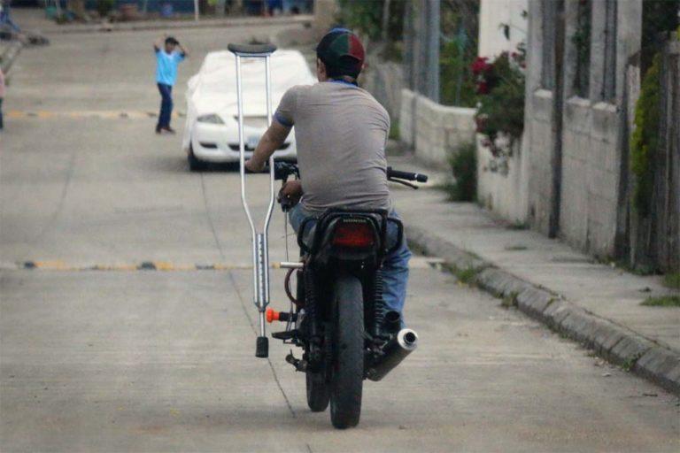 Robin one legged Motorcyclist Guatemala