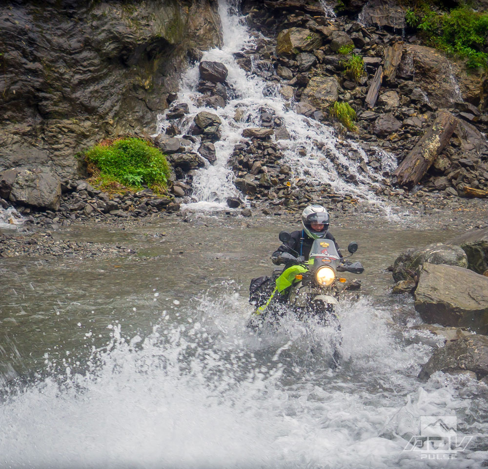 Riding through ice cold waterfalls on the way to Everest