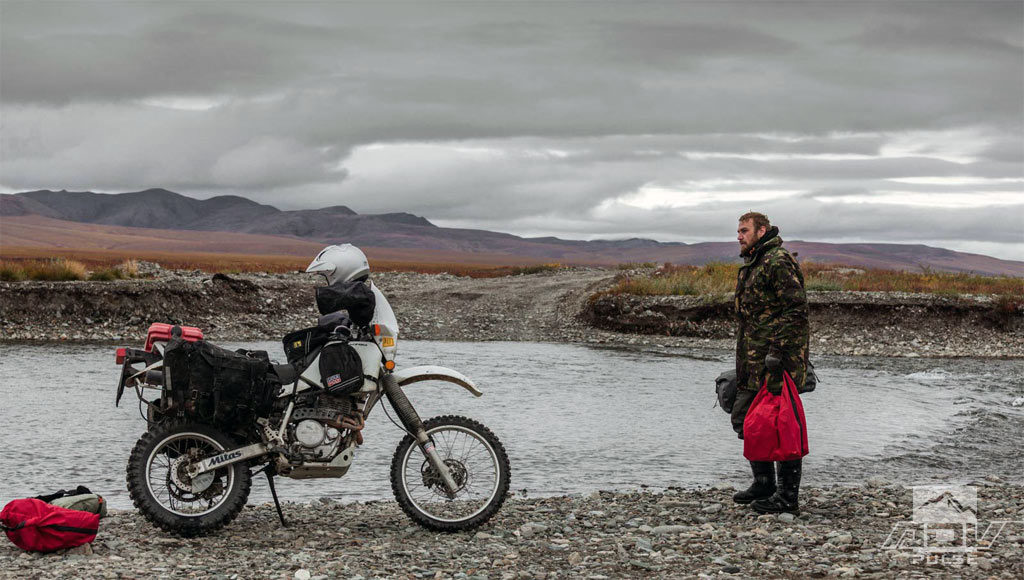 Deep river crossing on a motorcycle.