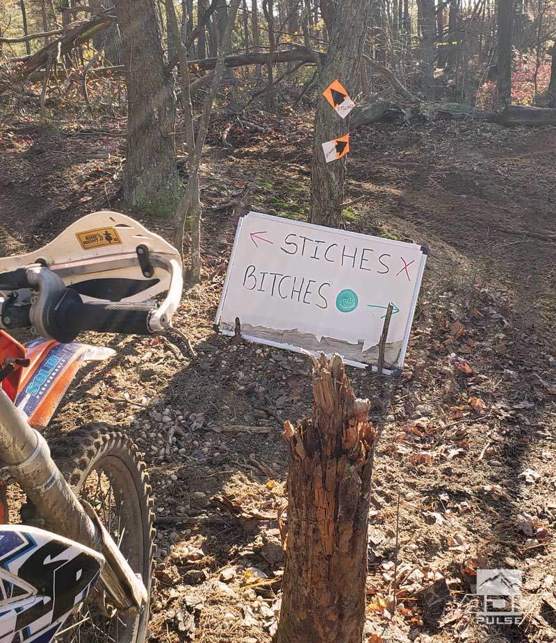 Stitches or Bitches sign at the Hammer Run