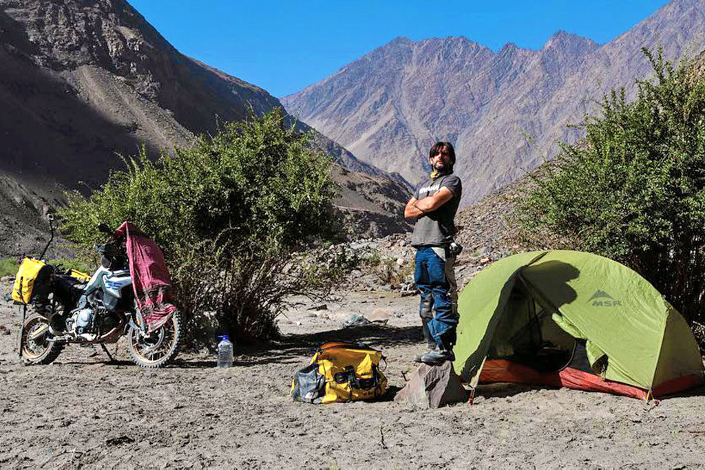 Businessman Charly Sinewan sells everything to ride the world as a nomad